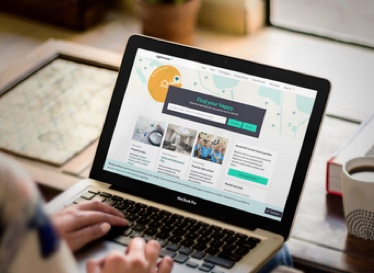 Photo of Macbook with Rightmove site opened